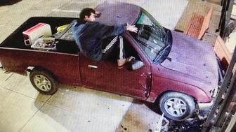 In this image taken from Harrison County surveillance video, released by the Harrison County Board of Supervisors, Keith Cavalier is seen climbing out of a Toyota Tacoma truck after it hit the east side of the courthouse in Gulfport, Miss., Saturday morning, Nov. 10, 2018. Cavalier, of Gulfport, was arrested in the incident on charges of driving under the influence and felony malicious mischief. (Harrison County Board of Supervisors via the AP)