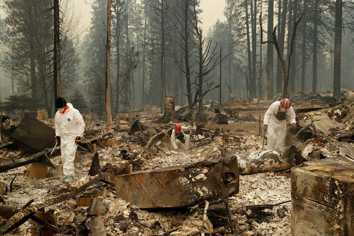 Search and rescue workers search for human remains at a trailer park burned in the Camp fire on Nov. 13, 2018, in Paradise, C