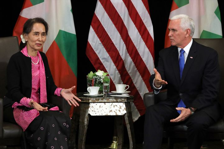 Myanmar leader Aung San Suu Kyi, left, discussed the case of two imprisoned Reuters reporters with Vice President Mike Pence,