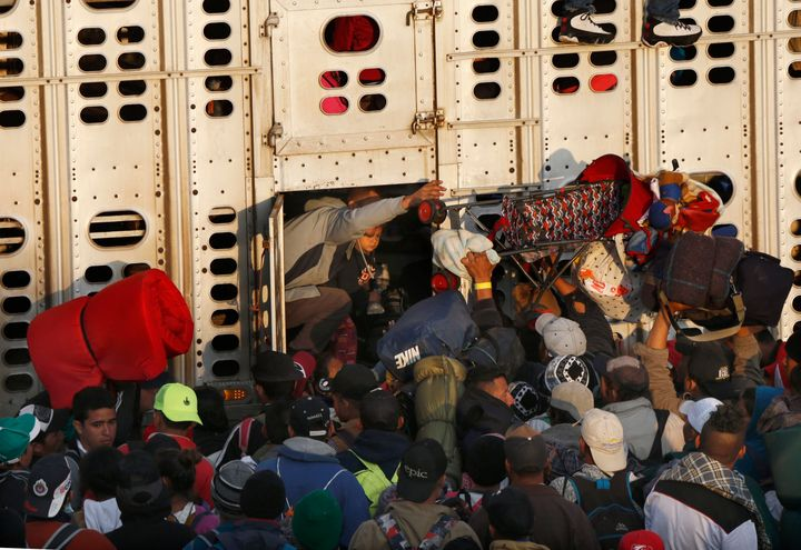 Central American migrants, part of the caravan hoping to reach the U.S. border, get a ride in a chicken truck, in Irapuato, M