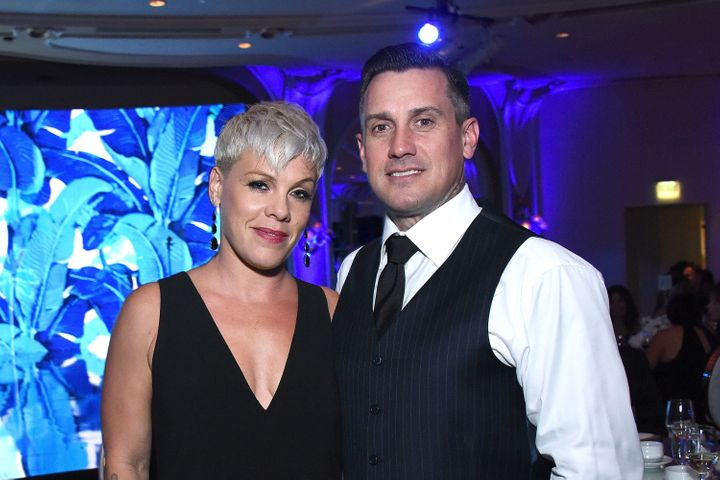 Singing star Pink with husband Carey Hart, who appeared to threaten looters with gunfire in a controversial Instagram post.&n