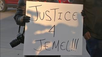 A group of demonstrators protested Tuesday outside the Midlothian Police Department following the police shooting of a night club security guard.