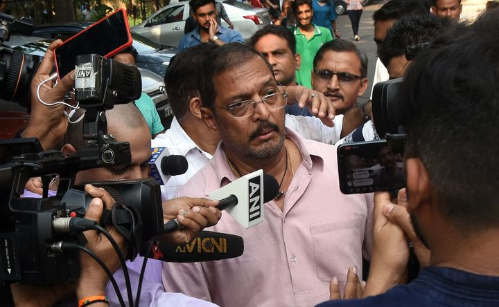 Indian Bollywood actor Nana Patekar is mobbed by the media as he leaves after making a statement outside his home in Mumbai o