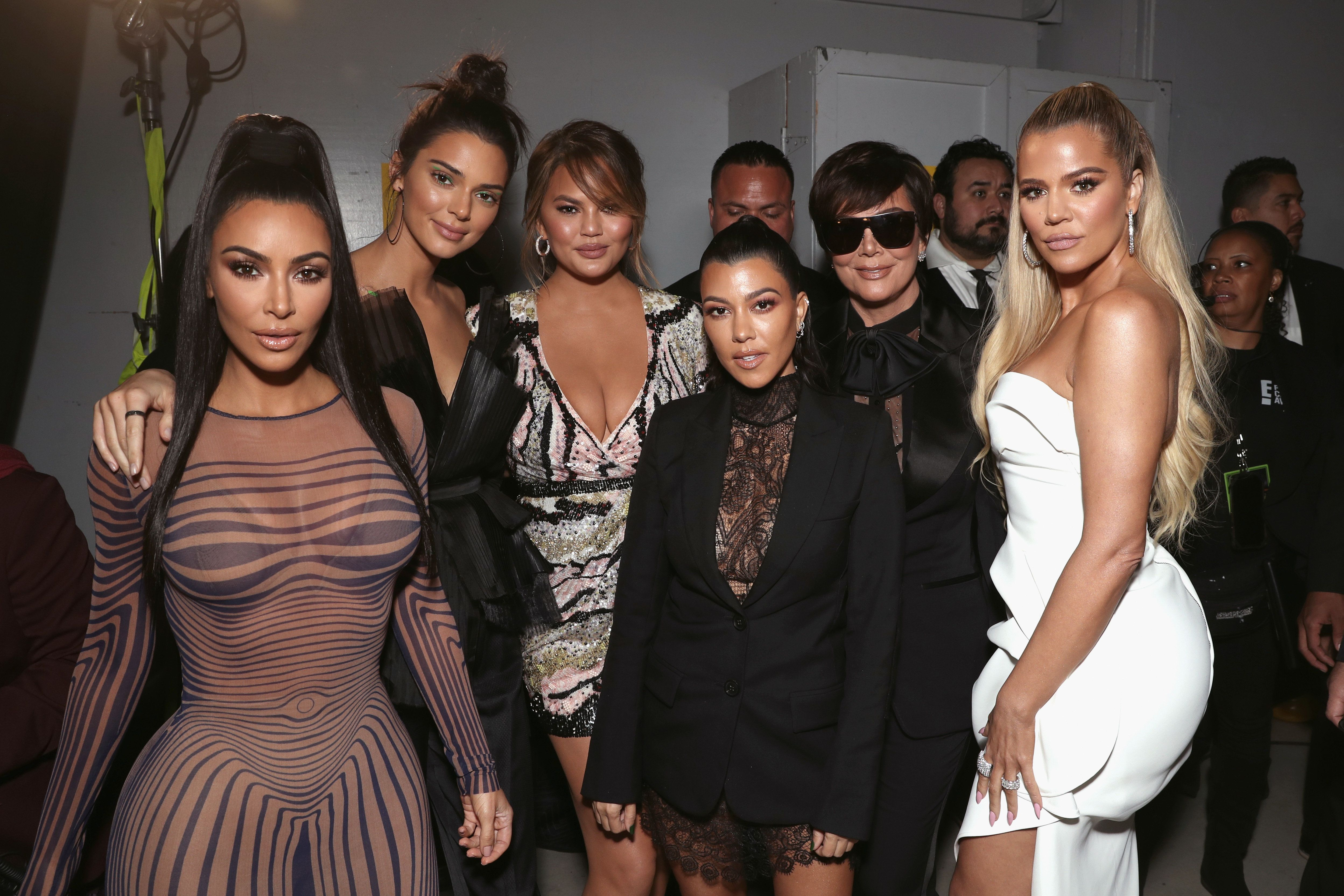 The KarJenner family poses with Chrissy Teigen backstage at the People's Choice Awards.