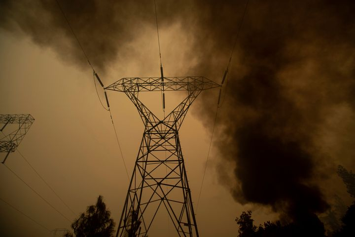 This type of power infrastructure hasn't been properly maintained by PG&E, the lawsuit claims. Here, smoke billows around