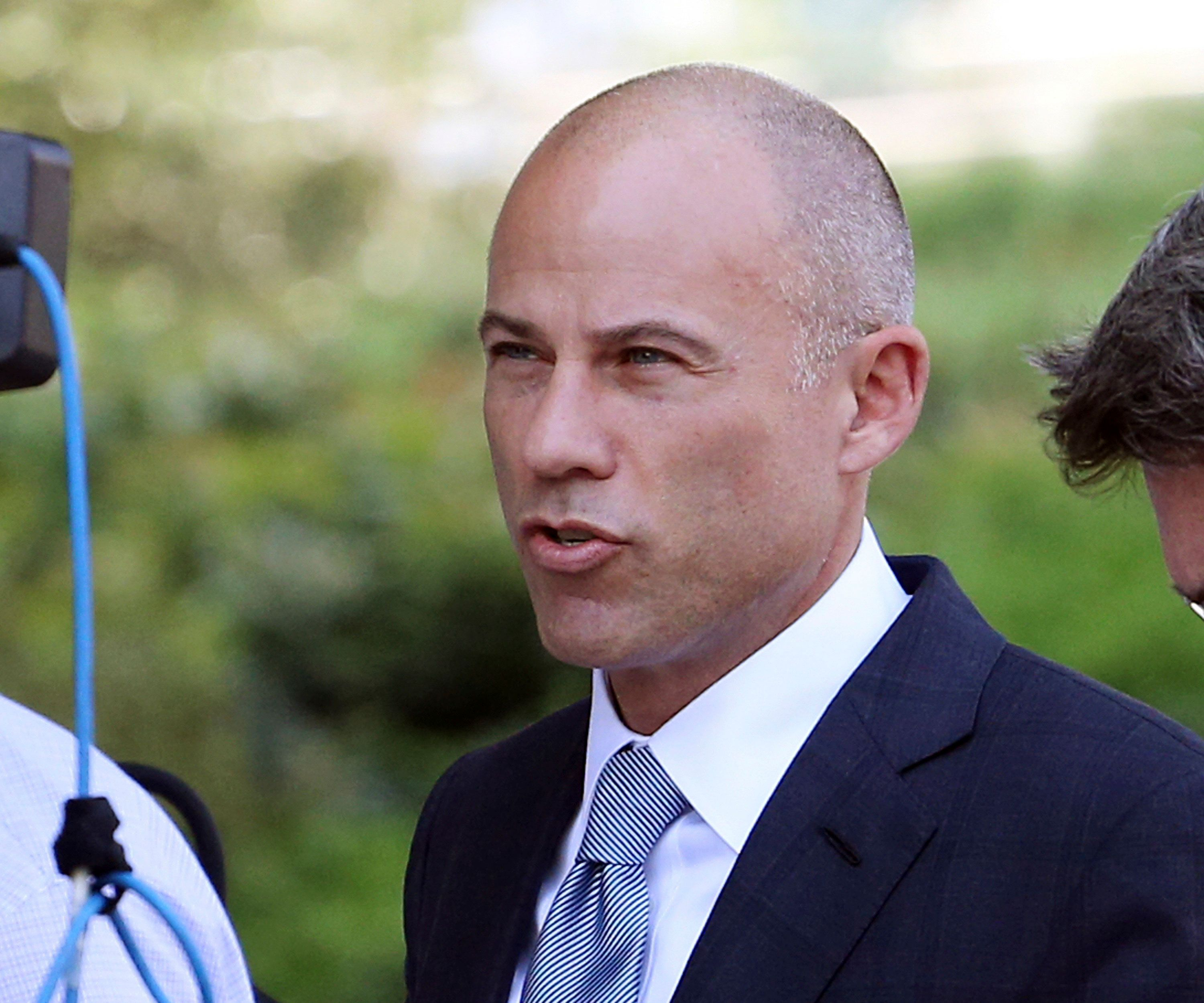 Michael Avenatti, attorney for porn actress Stormy Daniels, arrives at U.S. District Court in Los Angeles, Monday, Sept. 24, 2018. Lawyers for President Donald Trump are going to court to urge a judge to toss out a lawsuit by the actress, whose given name is Stephanie Clifford, over a hush-money deal over their alleged affair. Avenatti is expected to argue that the agreement that resulted in a $130,000 payout was not valid and they won't carry out threats to sue her for breaking the agreement. (AP Photo/Reed Saxon)
