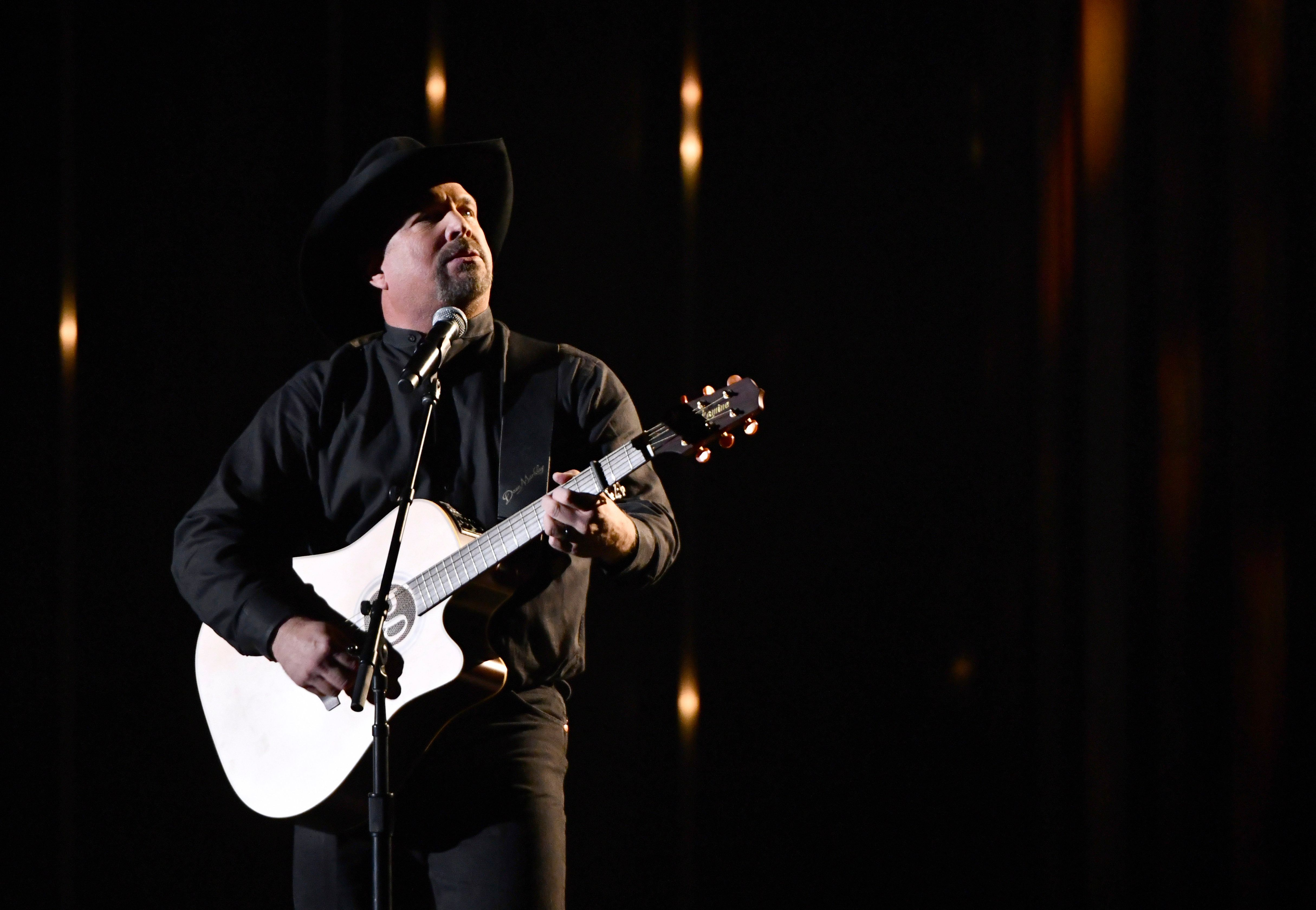 """Let the music unite us with love in their enduring memory,"" Garth Brooks said as a moment of silence honored the 12 killed at Borderline Bar & Grill."