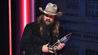 Chris Stapleton accepts the award for male vocalist of the year at the 52nd annual CMA Awards at Bridgestone Arena on Wednesday, Nov. 14, 2018, in Nashville, Tenn. (Photo by Charles Sykes/Invision/AP)