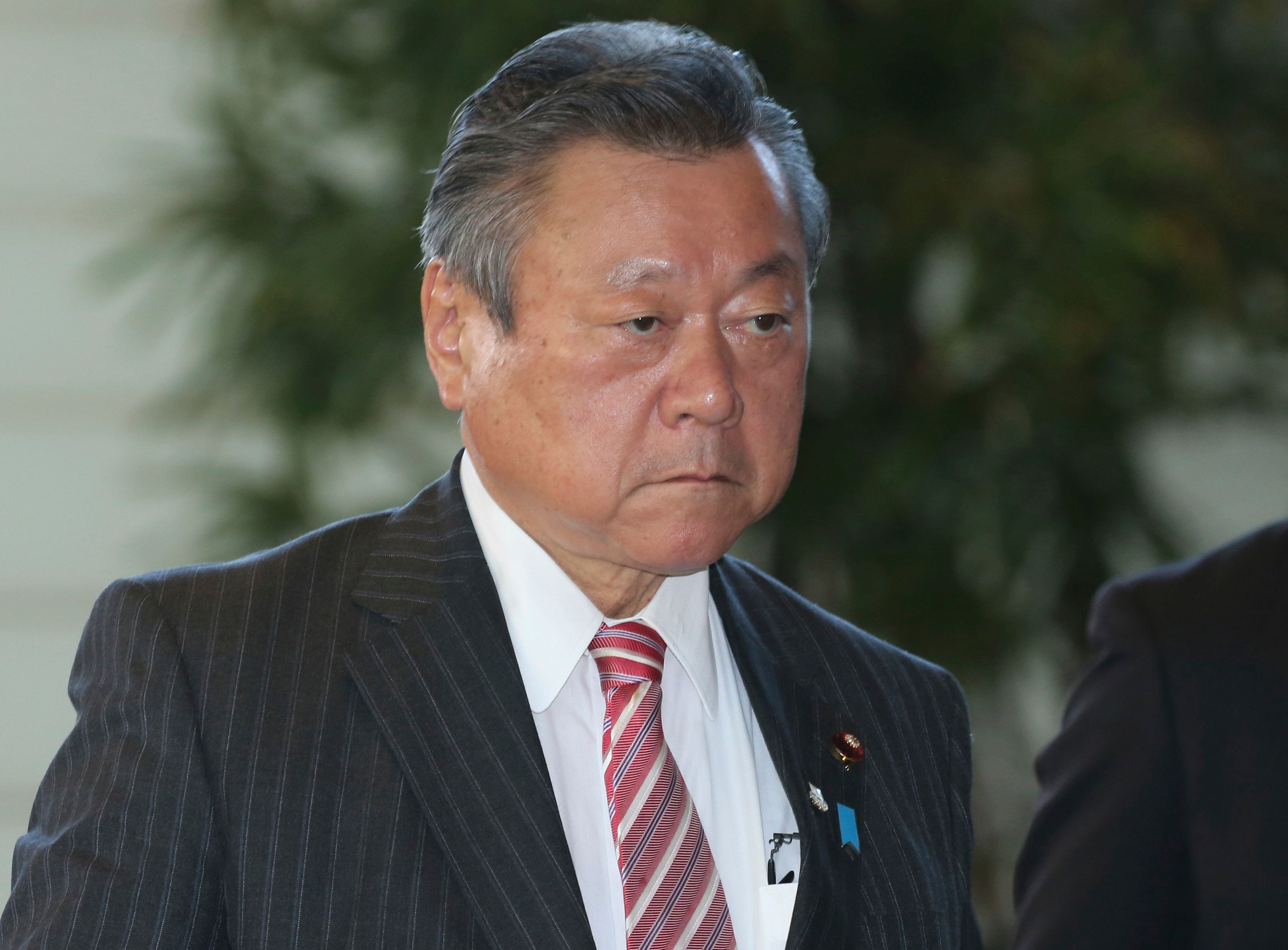 In this Oct. 2, 2018, file photo, Japan's Minister in Charge of Tokyo Olympics Yoshitaka Sakurada arrives at the prime minister's official residence in Tokyo. Sakurada, also the minister in charge of cybersecurity, is in the spotlight for acknowledging he had never used a computer and making comments showing he had no idea what a USB port might be. (AP Photo/Koji Sasahara, File)