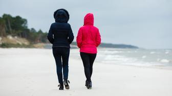 Women walking on the seasideWomen walking on the seaside