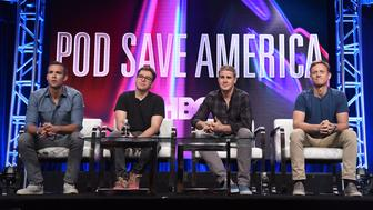 "Jon Favreau, from left, Jon Lovett, Dan Pfeiffer and Tommy Vietor participate in the ""Pod Save America"" panel during the HBO Television Critics Association Summer Press Tour at The Beverly Hilton hotel on Wednesday, July 25, 2018, in Beverly Hills, Calif. (Photo by Richard Shotwell/Invision/AP)"