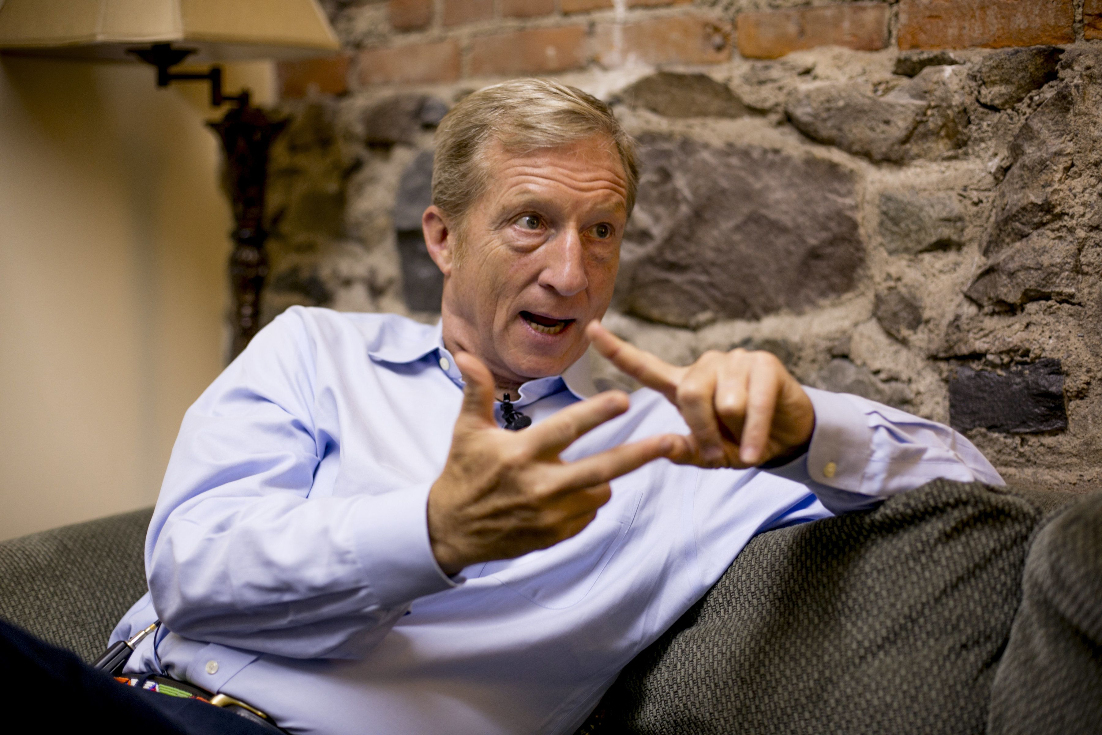 Tom Steyer, co-founder of NextGen Climate Action Committee, speaks backstage before a 'Need To Impeach' event in Lansing, Michigan, U.S., on Monday, Aug. 13, 2018. Steyer plans to spend an additional $10 million on helping Democrats take control of the House by attempting to drive up turnout among infrequent voters motivated by the idea of impeaching President Donald Trump. Photographer: Anthony Lanzilote/Bloomberg via Getty Images