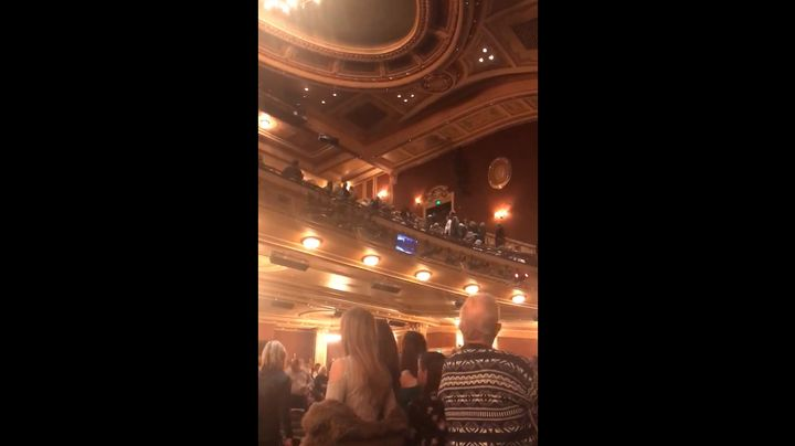 "Video taken inside of the Hippodrome theater shows stunned guests staring up into the balcony as others scream, ""Get ou"