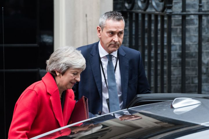 British Prime Minister Theresa May was barely clinging to power Thursday after two top officials resigned in the wake of her