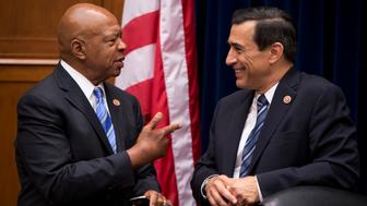 UNITED STATES - SEPTEMBER 19: Chairman of the House Oversight and Government Reform Committee Darrell Issa, R-Calif., right, and  Rep. Elijah Cummings, D-Md., ranking member, talk before a hearing in Rayburn titled 'Reviews of the Benghazi Attacks and Unanswered Questions.' (Photo By Tom Williams/CQ Roll Call)