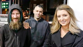 FILE – In this Nov. 17, 2017, file photo, Johnny Bobbitt Jr., left, Kate McClure, right, and McClure's boyfriend Mark D'Amico pose at a Citgo station in Philadelphia. A New Jersey prosecutor was set to announce developments Thursday, Nov. 15, 2018, in a criminal investigation of the couple that raised $400,000 for Bobbitt Jr, a homeless man they said helped them with a disabled car. Burlington County Prosecutor Scott Coffina planned to discuss the matter during a news conference. He declined to provide further details about the announcement or whether criminal charges would be brought in the case. (Elizabeth Robertson /The Philadelphia Inquirer via AP, File) /The Philadelphia Inquirer via AP)