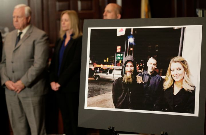 A picture of Katelyn McClure, right, Mark D'Amico, center, and Johnny Bobbitt Jr., left, displayed during a news conference i