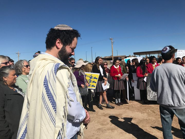 Rabbi Josh Whinston (front) and others gather outside the Tornillo detention camp in Texas on Thursday to protest the detainm