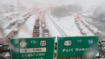 NEWARK, NJ - NOVEMBER 15: Traffic sits at a standstill on a highway by Newark Liberty Airport as snow falls in the New York City area on November 15, 2018  in Newark, New Jersey. The early season storm caused flight cancellations in much of the northeast. (Photo by Gary Hershorn/Getty Images)