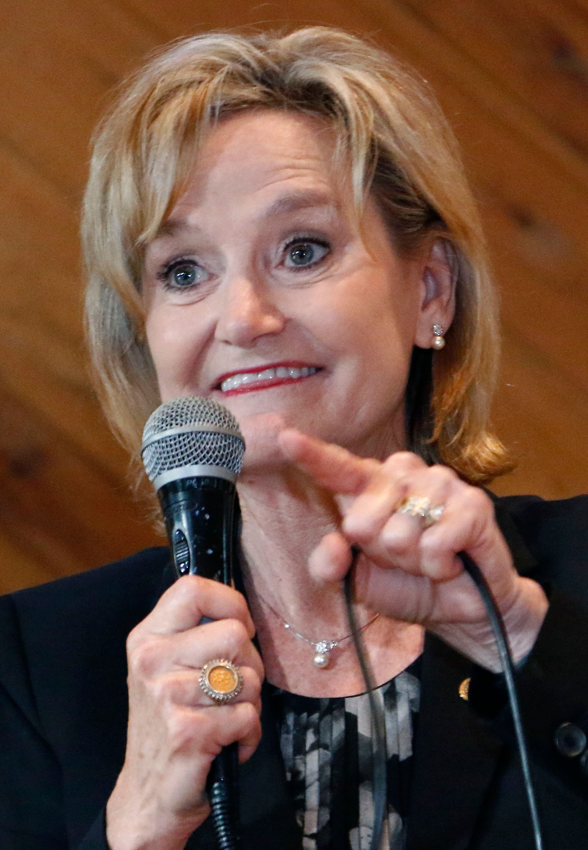 U.S. Sen. Cindy Hyde-Smith, R-Miss., addresses a gathering of supporters in Jackson, Miss., Monday, Nov. 5, 2018. Hyde-Smith hopes to get elected to serve the last two years of the six-year term vacated when Republican Thad Cochran retired for health reasons. State Sen. Chris McDaniel, R-Ellisville, former military intelligence officer Tobey Bernard Bartee and former Democratic congressman and Agriculture Secretary under the Clinton Administration Mike Espy are also running in the non-partisan race. (AP Photo/Rogelio V. Solis)