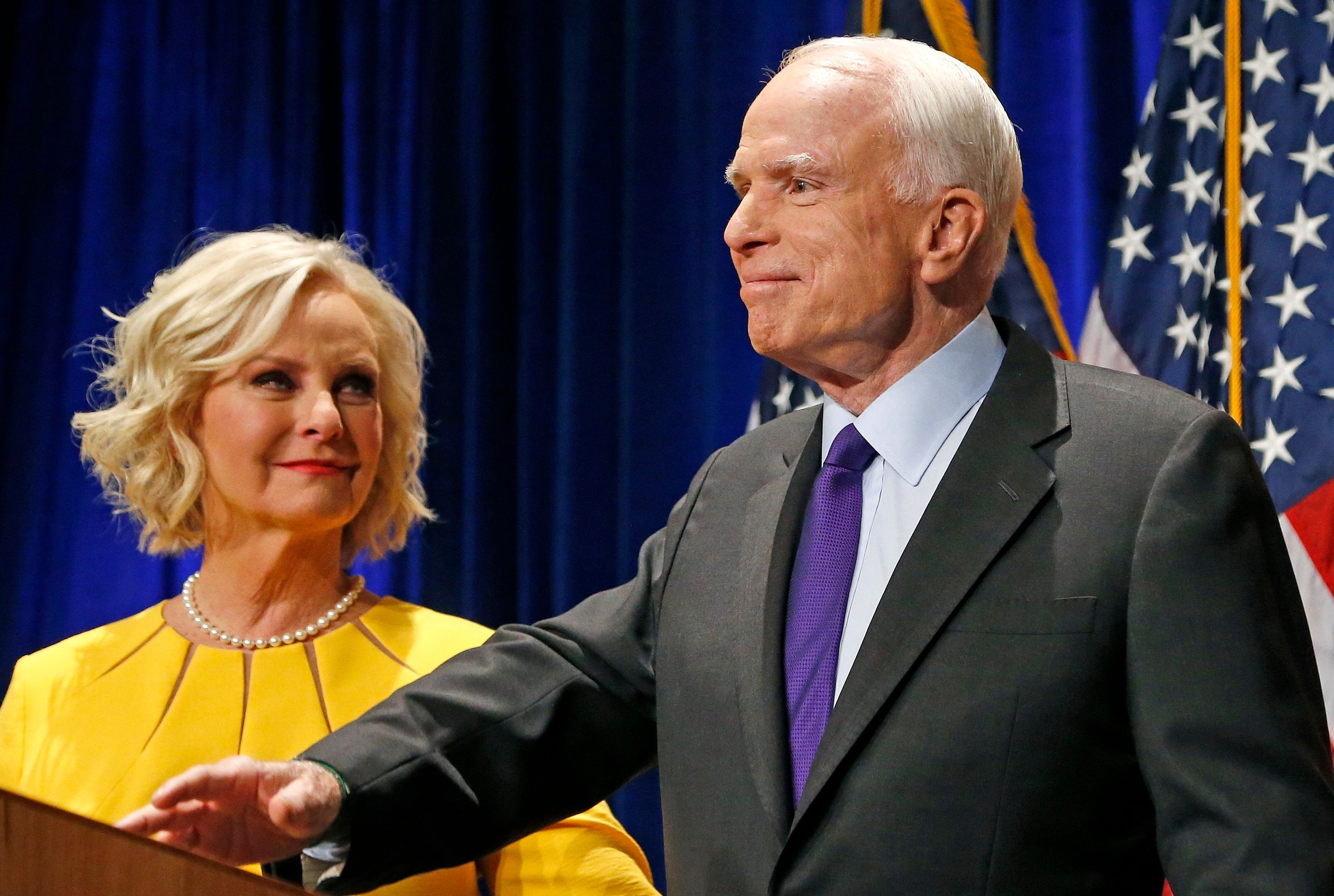 Sen. John McCain, R-Ariz., right, pauses as his wife Cindy McCain, left, looks at him on stage after giving his victory speech as he announces his win over Democratic challenger Rep. Ann Kirkpatrick Tuesday, Nov. 8, 2016, in Phoenix. (AP Photo/Ross D. Franklin)