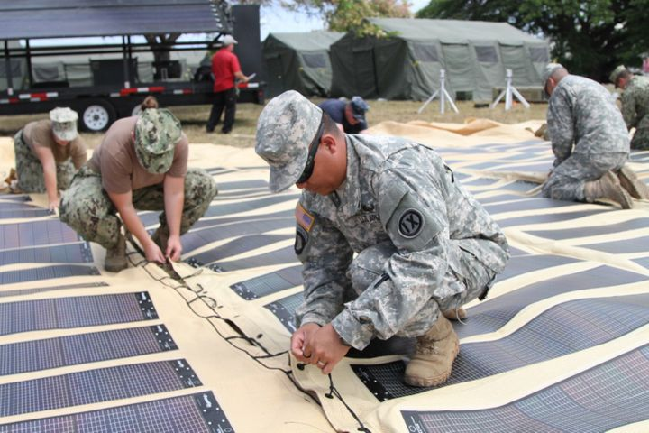 The U.S. Army is increasingly deploying solar power in the field. Above, soldiers assemble a solar shade canopy during a trai