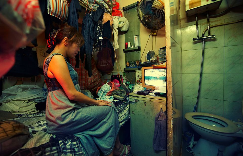 Asubdivided unit in the Kowloon area of Hong Kong highlights the cramped conditions in which many...