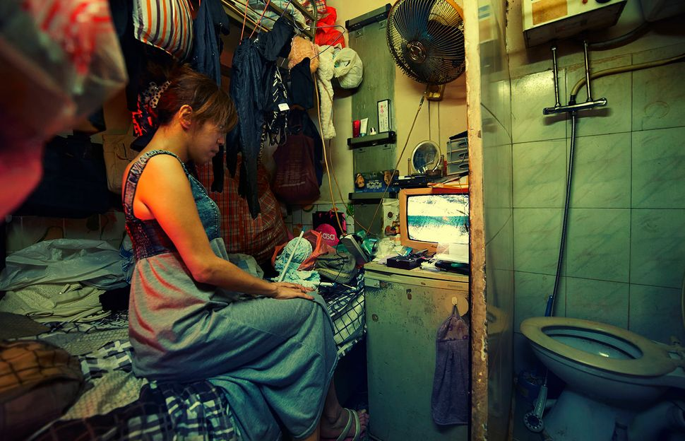 A subdivided unit in the Kowloon area of Hong Kong highlights the cramped conditions in which many are forced to live.