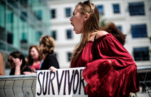 Meghan Downey of Chatham, New Jersey, protests in Arlington, Virginia, as U.S. Education Secretary Betsy...