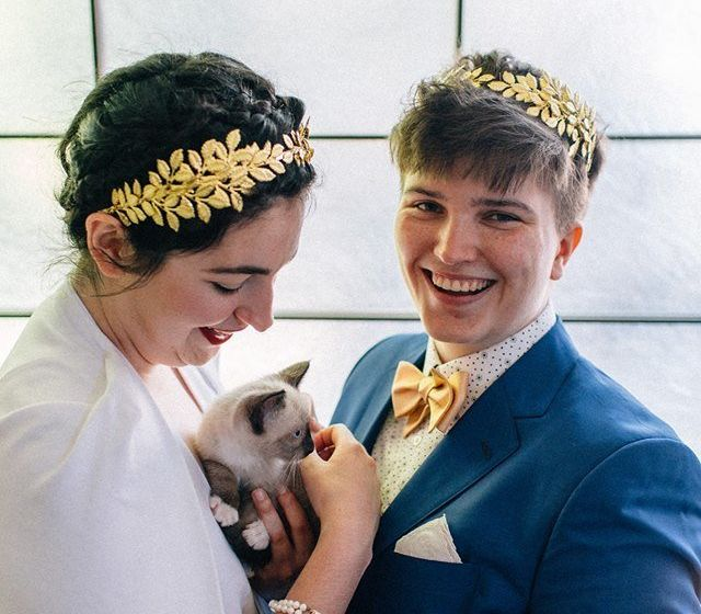 Colleen (left), a kitty and Iz on their wedding day.