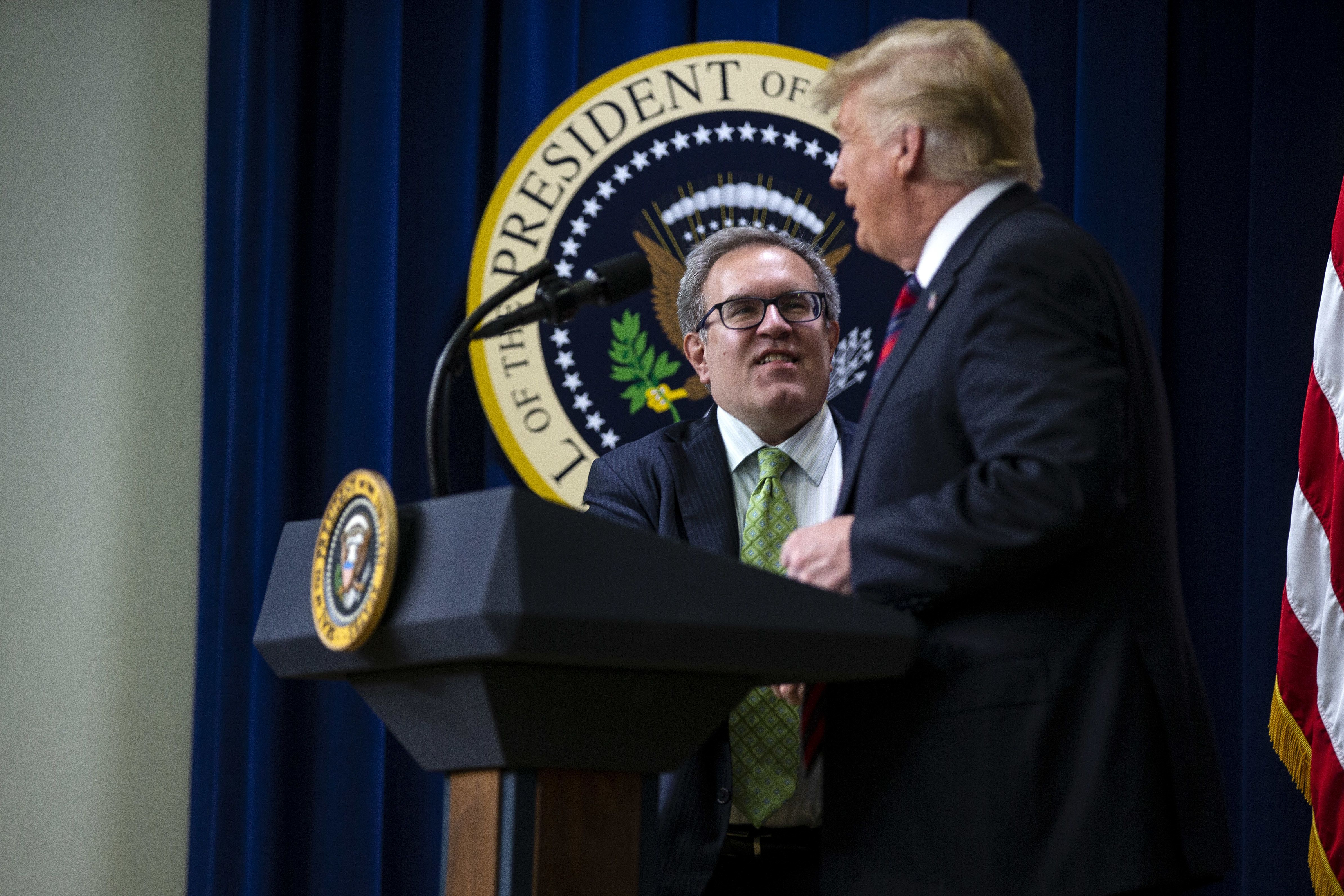 Andrew Wheeler, acting administrator of the Environmental Protection Agency (EPA), arrives on stage with U.S. President Donald Trump during the White House State Leadership Day conference in Washington, D.C., U.S., on Tuesday, Oct. 23, 2018. Trump said he is passing responsibility to Congress for responding to the killing of U.S.-based journalist Jamal Khashoggi at a Saudi consulate in Istanbul. Photographer: Al Drago/Bloomberg via Getty Images