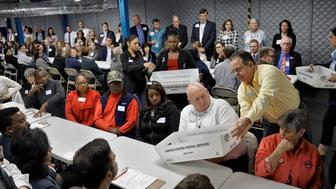 Votes are placed in front of volunteers during an elections manual recount for three undecided races Friday, Nov. 16, 2018, in Tampa, Fla. (AP Photo/Chris O'Meara)