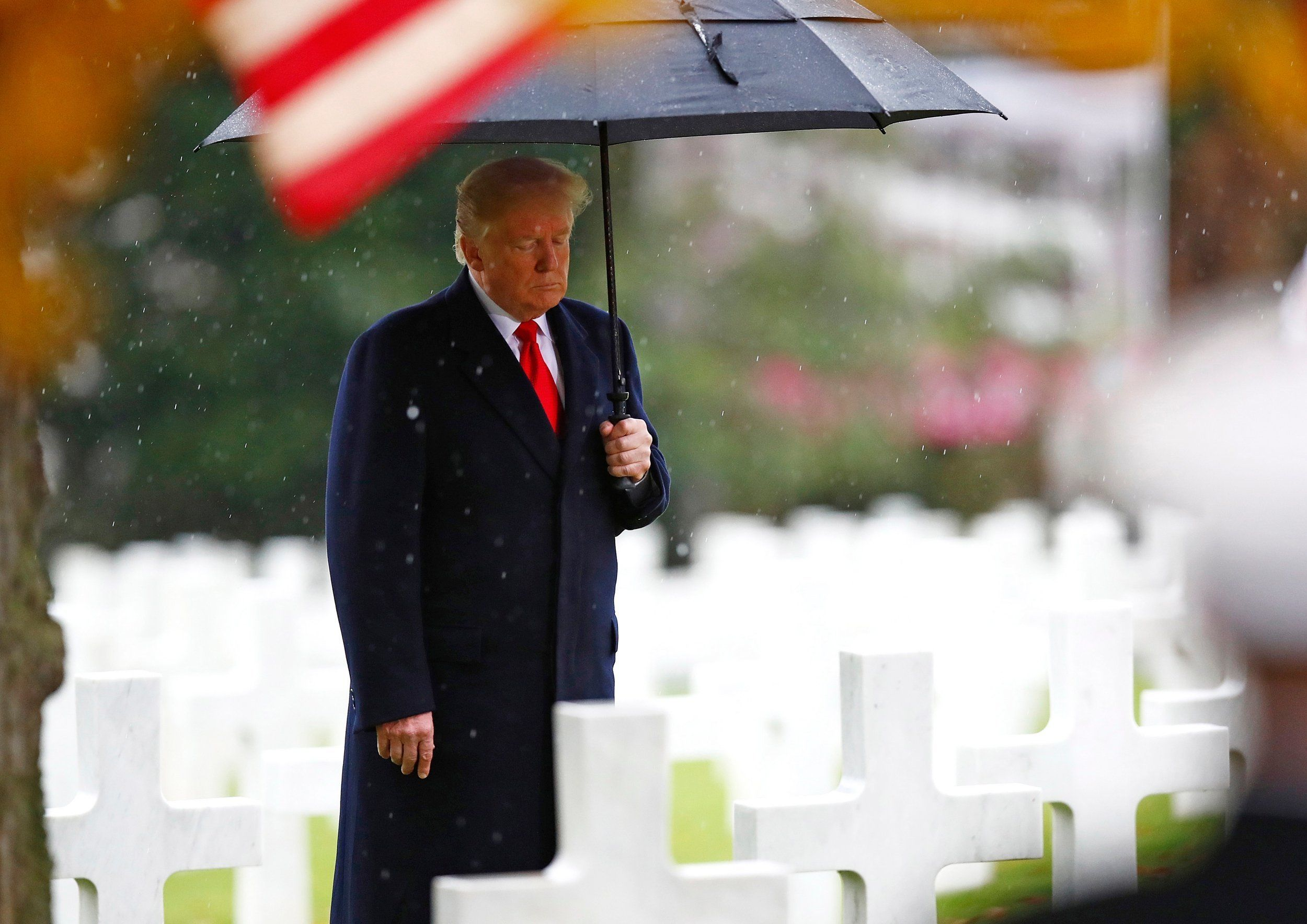 Donald Trump rain: President jokingly complains about 'getting drenched' at Armistice ceremony a day after cancelling cemetery trip due to bad weather