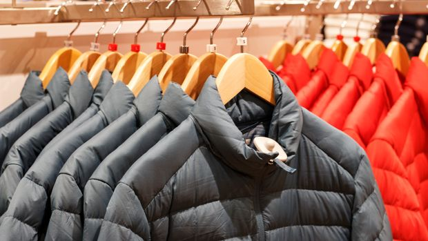 Winter jackets on a hanger in the store close-up