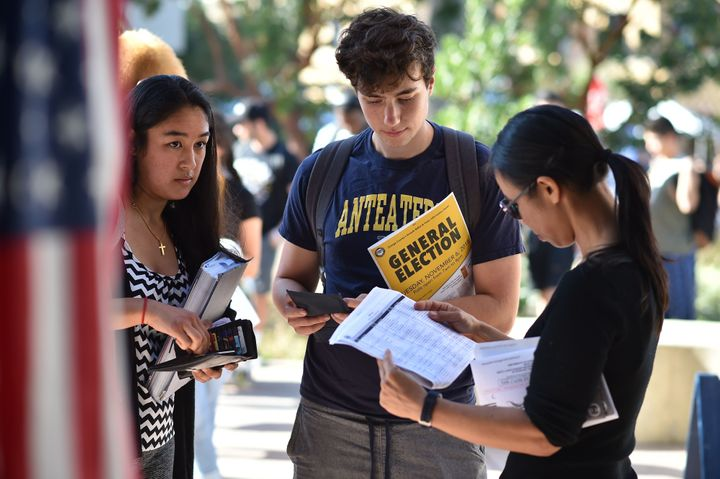 Students wait in line to vote at the University of California, Irvine, on Nov. 6.