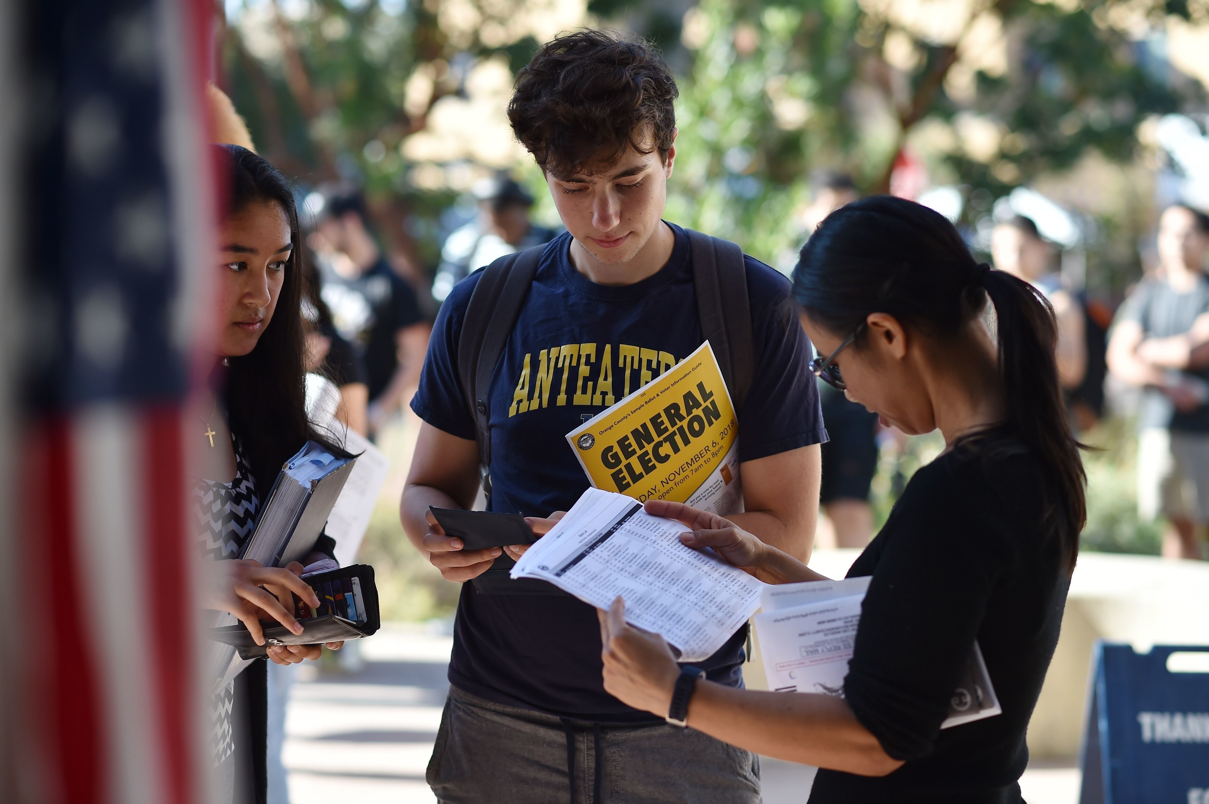 Students wait in line to cast their ballot at a polling station on the campus of the University of California, Irvine, on November 6, 2018 in Irvine, California on election day. - Americans vote Tuesday in critical midterm elections that mark the first major voter test of Donald Trump's presidency, with control of Congress at stake. (Photo by Robyn Beck / AFP)        (Photo credit should read ROBYN BECK/AFP/Getty Images)