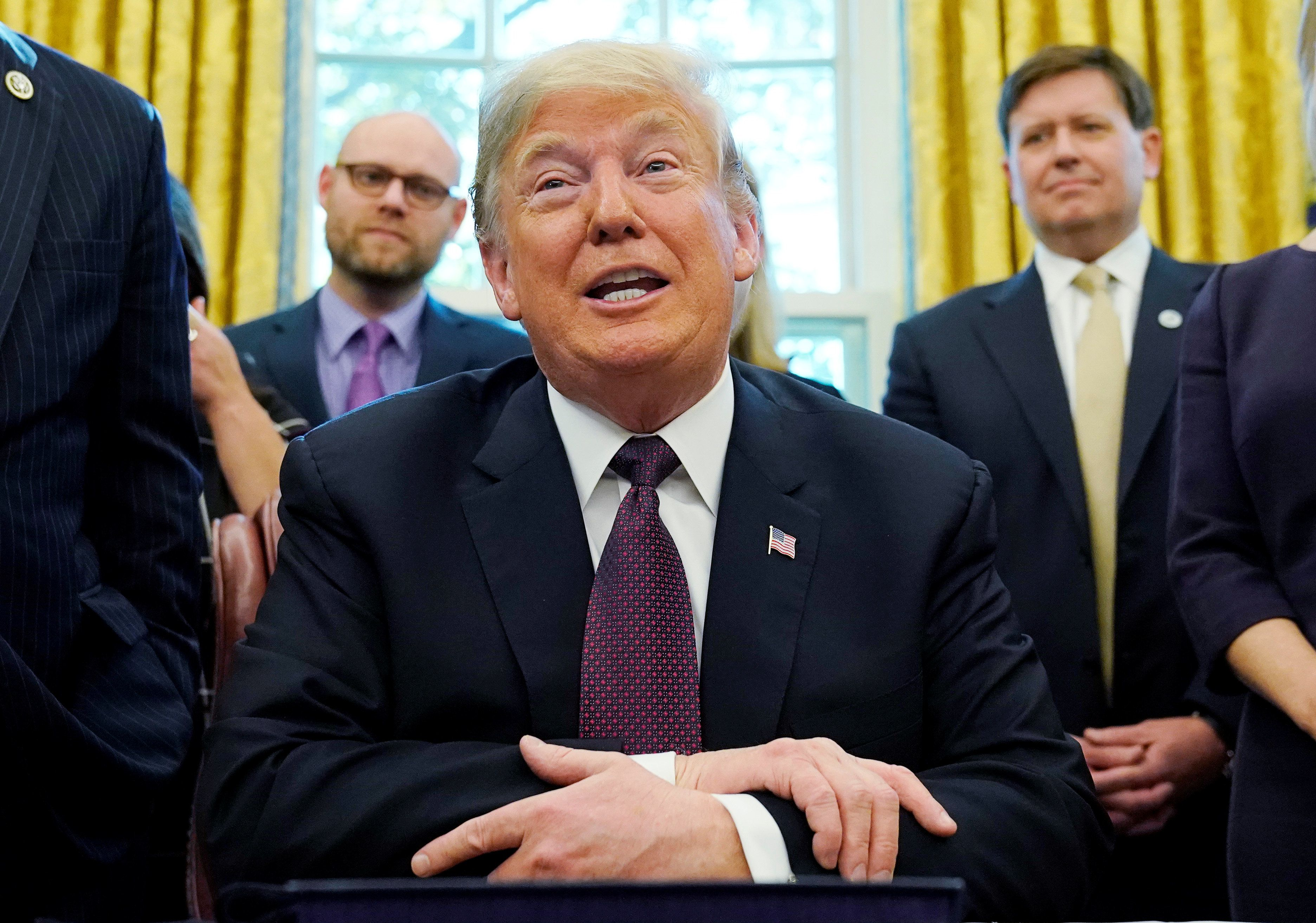U.S. President Donald Trump talks to reporters at a signing ceremony for the Cybersecurity and Infrastructure Security Agency Act in the Oval Office of the White House in Washington, U.S. November 16, 2018. REUTERS/Jonathan Ernst