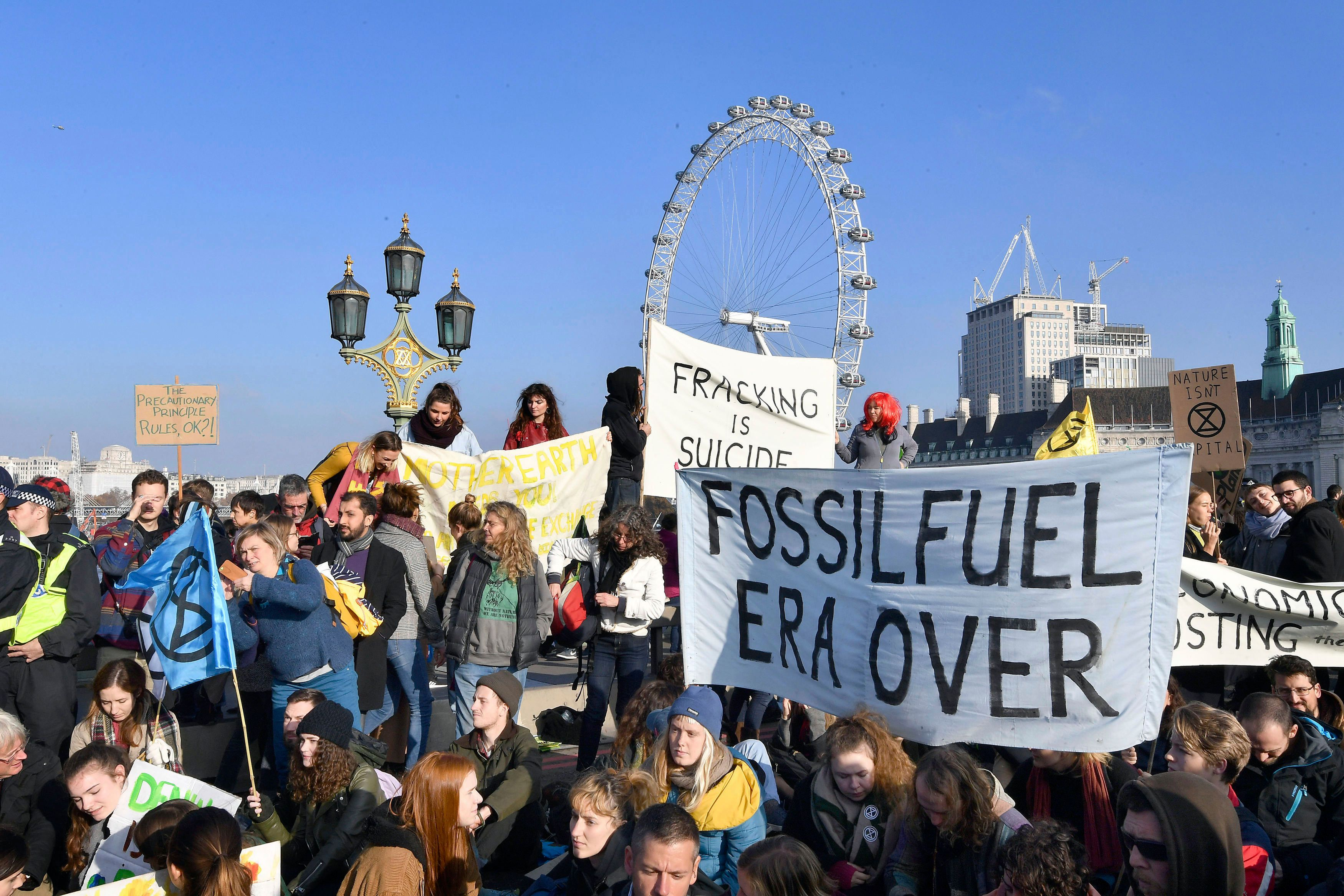 Climate change activists block bridges across London
