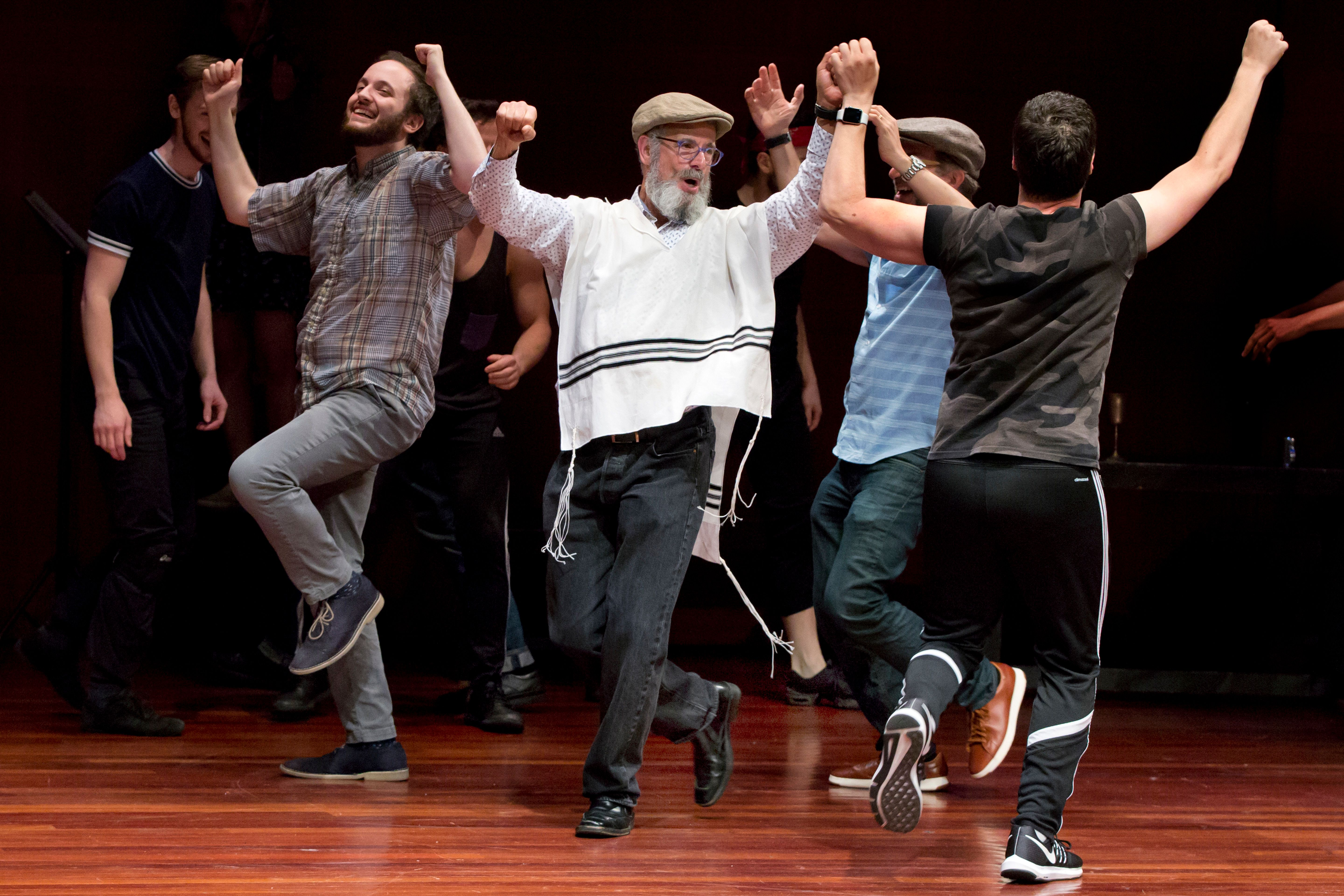 """In this Tuesday, June 19, 2018, photo, Steven Skybell, center, as Tevye, rehearses with the National Yiddish Theatre Folksbiene cast of a Yiddish-language production of """"Fiddler on the Roof,"""" at the at the Museum of Jewish Heritage, in New York. (AP Photo/Richard Drew)"""