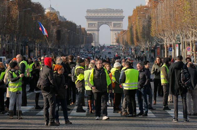 Protesters block the Champs Elysees avenue to protest fuel taxes in Paris, France, on Saturday.