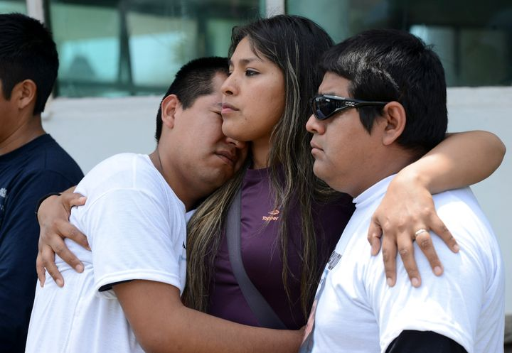 Relatives of Mario Armando Toconas, crew member of the missing ARA San Juan submarine, hug outside the navy base in Mar del P