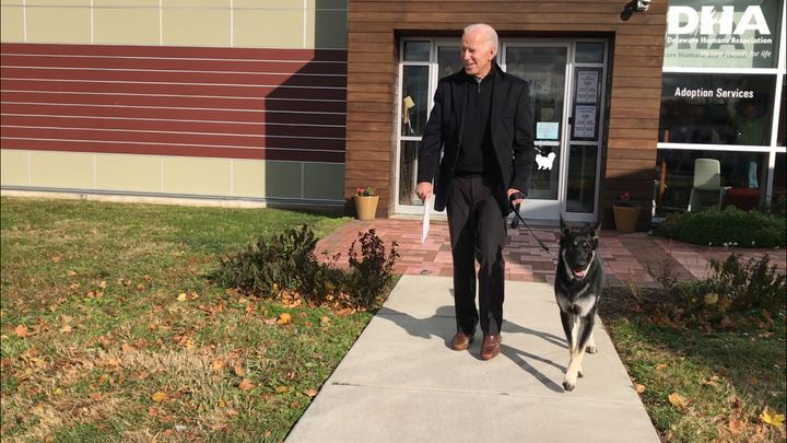Joe Biden walks out of the Delaware Humane Association with his canine pal Major.