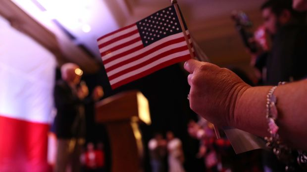 HOUSTON, TEXAS - NOVEMBER 06:  A supporter of U.S. Sen. Ted Cruz (R-TX) holds an American flag during an election night gathering at the Hilton Houston Post Oak on November 06, 2018 in Houston, Texas. Sen. Cruz is in a tight race against democratic challenger U.S. Rep. Beto O'Rourke (D-TX) to save his Senate seat.  (Photo by Justin Sullivan/Getty Images)