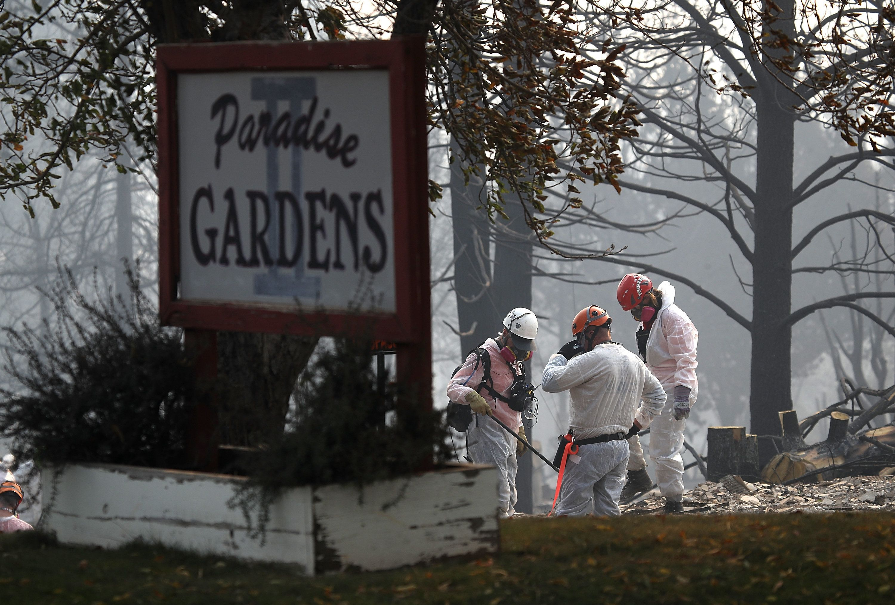 PARADISE, CA - NOVEMBER 16:  Rescue workers search the Paradise Gardens apartments for victims of the Camp Fire on November 16, 2018 in Paradise, California. Fueled by high winds and low humidity the Camp Fire ripped through the town of Paradise charring over 140,000 acres, killed at least 63 people and has destroyed over 11,000 homes and businesses. The fire is currently at 45 percent containment and 631 people still remain missing.  (Photo by Justin Sullivan/Getty Images)