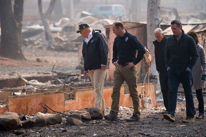 President Donald Trump toured areas affected by the deadly wildfires on Saturday.