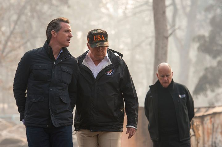 President Donald Trump talks with California Gov.-elect Gavin Newsom during a visit to a neighborhood destroyed by the wildfi