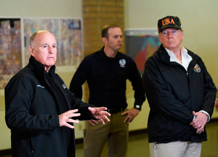 President Donald Trump looks on as the Governor of California Jerry Brown (L) speaks to the media at the Chico Command Center