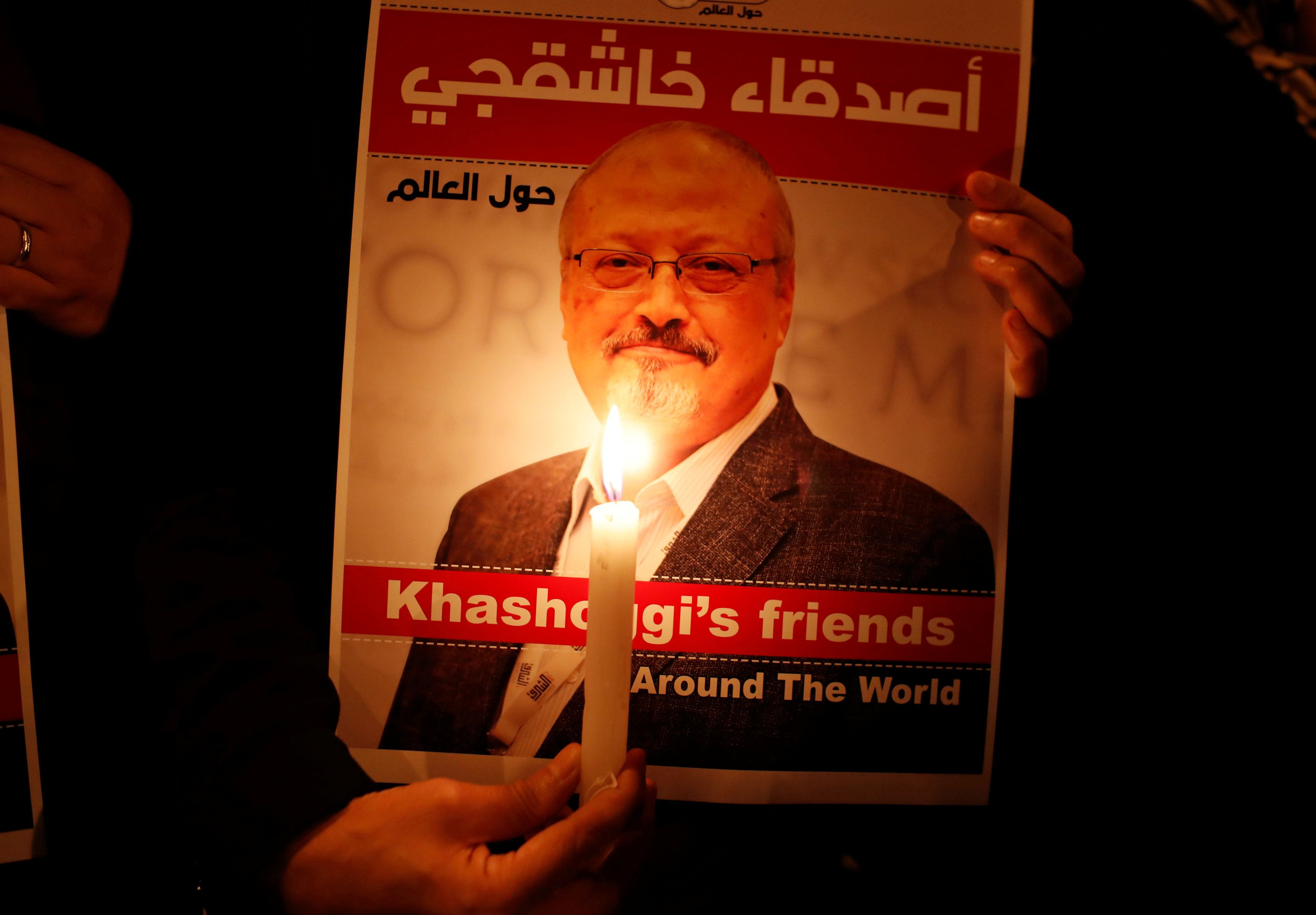 A demonstrator holds a poster with a picture of Saudi journalist Jamal Khashoggi outside the Saudi Arabia consulate in Istanbul, Turkey October 25, 2018. REUTERS/Osman Orsal
