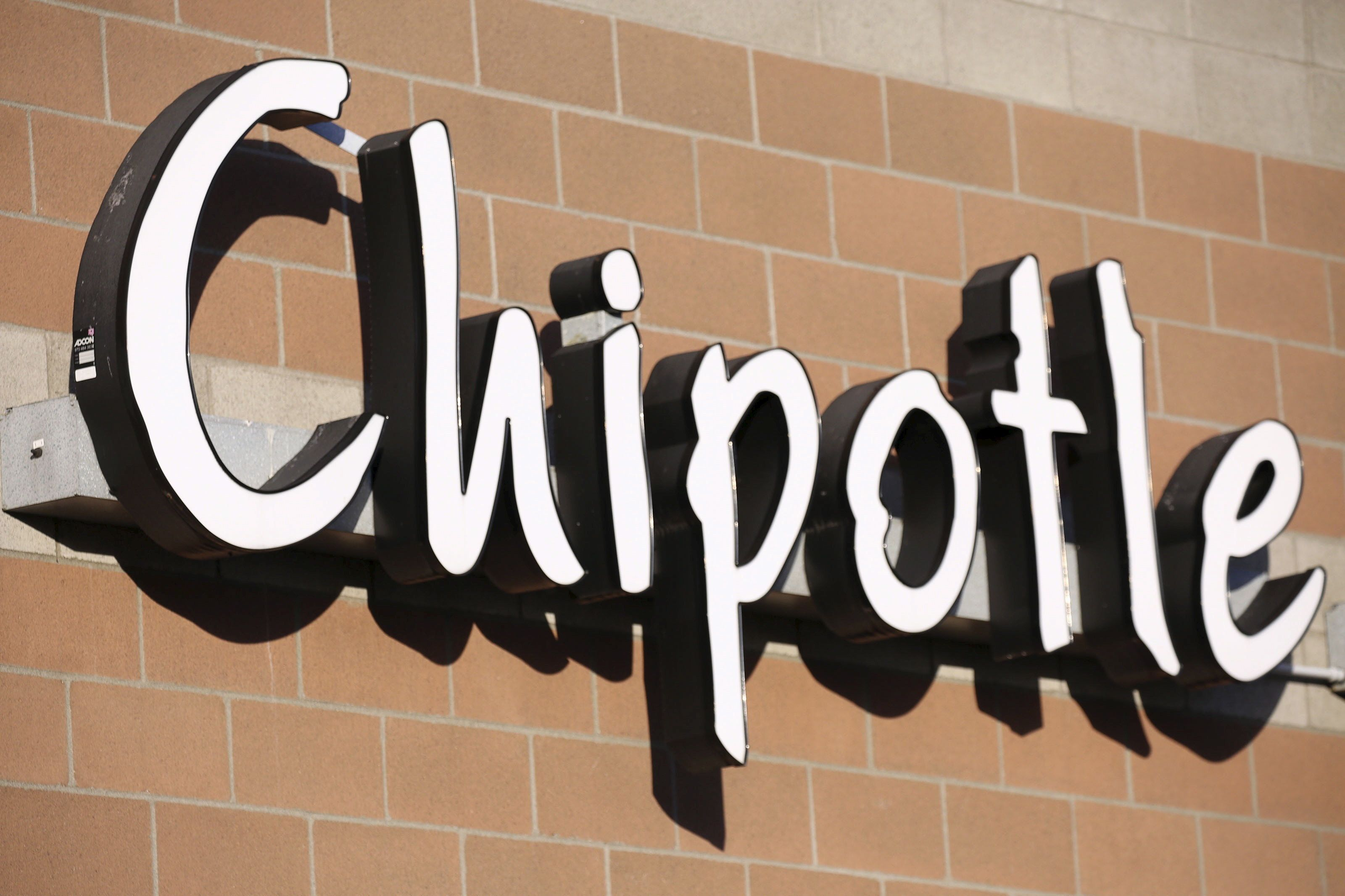 The sign of a Chipotle restaurant is shown in Federal Way, Washington November 20, 2015. The U.S. Centers for Disease Control and Prevention (CDC) said on Friday that three additional states reported E. coli infections from the same strain as the Chipotle Mexican Grill outbreak, sending shares in the chain down more than 12 percent. REUTERS/David Ryder