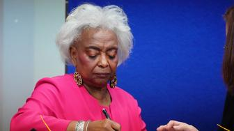 Broward County Supervisor of Elections Brenda Snipes signs a box during a ballot recount in Lauderhill, Florida, U.S., November 12, 2018. REUTERS/Carlo Allegri